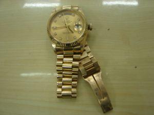 請問我有一支 ROLEX 勞力士 K金全紅的 錶帶壞了 轉時間那根也壞了 請問這樣你們會收嗎